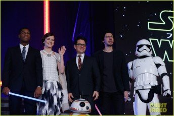 TOKYO, JAPAN - DECEMBER 10: (from left) John Boyega, Daisy Ridley, J.J. Abrams, BB-8, Adam Driver and Stormtrooper attend the 'Star Wars: The Force Awakens' fan event at the Roppongi Hills on December 10, 2015 in Tokyo, Japan. (Photo by Christopher Jue/Getty Images for Walt Disney Studios)