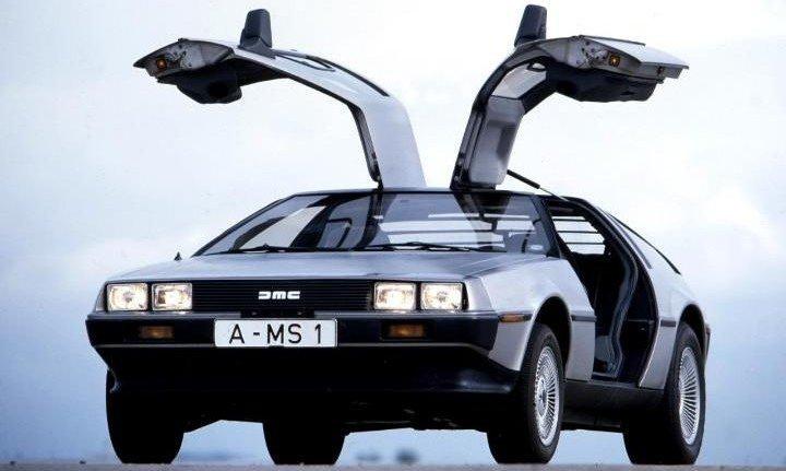 1-DeLorean-DMC-12-doors-open-large_trans++rWYeUU_H0zBKyvljOo6zlkYMapKPjdhyLnv9ax6_too
